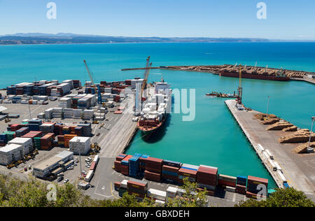 Container ship unloading at Napier docks, New Zealand - Stock Photo