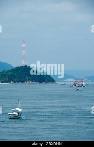 Small traditional Japanese fishing boats in the Seto Inland Sea. - Stock Photo
