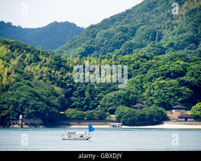 Two small traditional Japanese fishing boats in the Seto Inland Sea. - Stock Photo