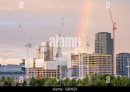 Rainbow over the new International Quarter, Olympic Park, Stratford, London UK. July 2016 - Stock Photo
