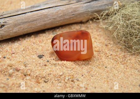 Carnelian on beach - Stock Photo