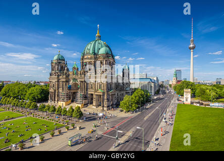 Aerial view of Berlin Cathedral with famous TV tower in the background on a sunny day with blue sky and clouds, - Stock Photo
