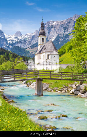Scenic mountain landscape in the Bavarian Alps with famous Parish Church of St. Sebastian in the village of Ramsau - Stock Photo