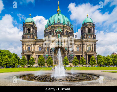 Berlin Cathedral with famous TV tower in the background on a sunny day with blue sky and clouds in summer, Berlin, - Stock Photo