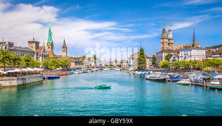 Panoramic view of historic Zurich city center with famous Fraumunster and Grossmunster Churches and river Limmat - Stock Photo