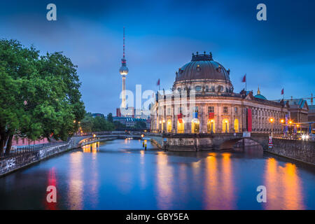 Beautiful view of historic Berlin Museumsinsel with famous TV tower and Spree river in twilight during blue hour - Stock Photo