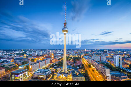 Aerial classic view of Berlin skyline with famous TV tower at Alexanderplatz and dramatic cloudscape in twilight, - Stock Photo
