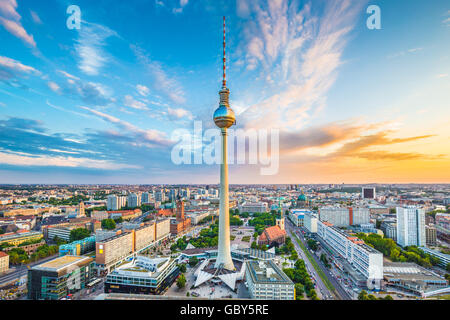 Classic view of Berlin skyline with famous TV tower at Alexanderplatz and dramatic cloudscape at sunset, Germany - Stock Photo