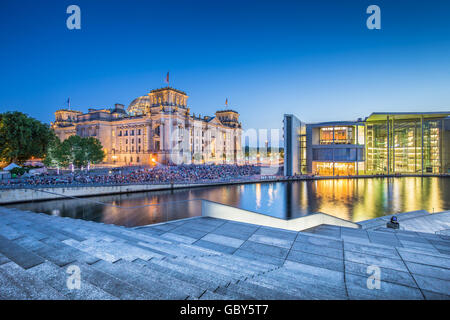 Panoramic view of Berlin government district with famous Reichstag building and Spree river in twilight at dusk, - Stock Photo