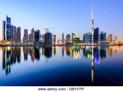 Panoramic view of Downtown Dubai reflecting on the canal with Burj Khalifa, Dubai Icon, United Arab Emirates - Stock Photo