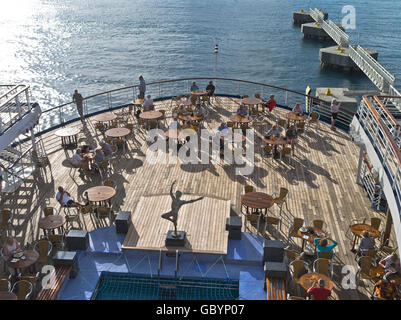 dh Marco Polo CRUISE SHIP CARIBBEAN Aft deck passengers enjoying evening Caribbean sun aboard people liner - Stock Photo