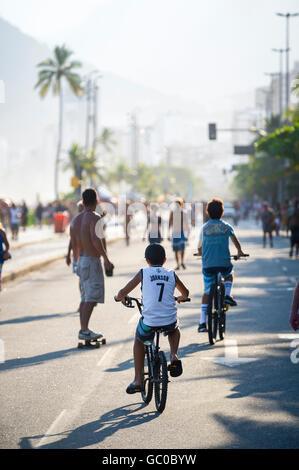 RIO DE JANEIRO - MARCH 6, 2016: Active residents take advantage of a car-free Sunday afternoon on the beachfront Avenida Vieira
