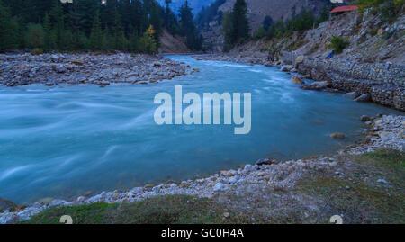 Beautiful Baspa river flowing through Sangla valley of Himachal Pradesh - Stock Photo