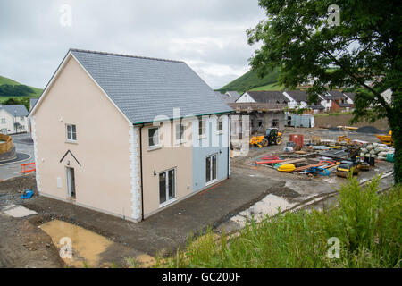 New detached and semi-detached houses being built on a private housing estate on the outskirts of Aberystwyth Wales - Stock Photo