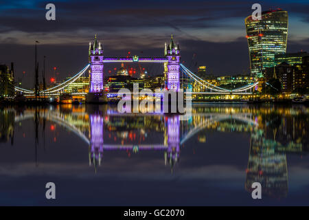 Illuminated London cityscape with Tower Bridge and Fenchurch building at sunset - Stock Photo