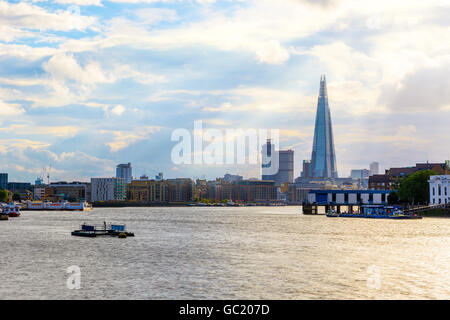 London cityscape with rays of sunlight shining through clouds - Stock Photo