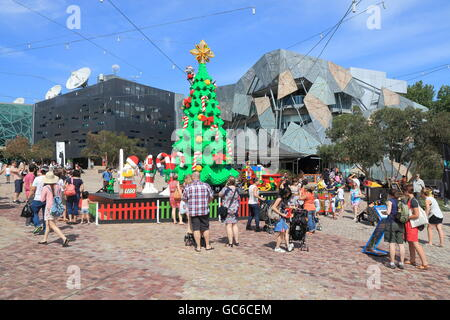 Ppeople take photo with Melbourne's X'mas tree in Federation Square - Stock Photo