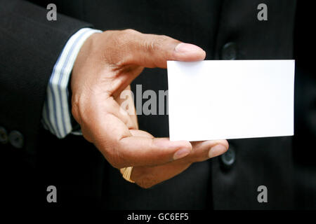 Business Card by a Men - Stock Photo