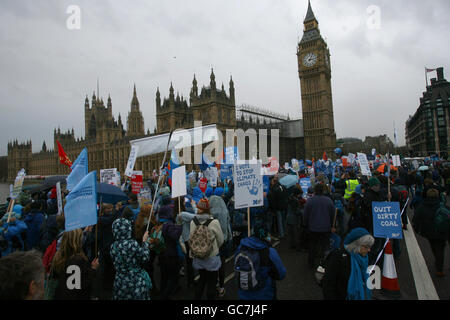Climate change protestors form a human wave around the Houses of Parliament in central London, as tens of thousands of people join in demonstrations calling for action on climate change ahead of crunch UN talks in Copenhagen.