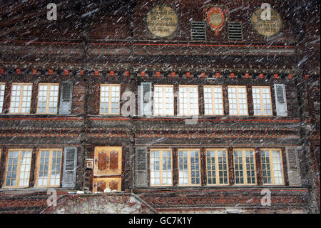 The 'Stucki houise' a decorated historic log house in Bernese traditional style  with snow, Reichenbach, Switzerland - Stock Photo