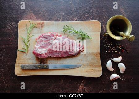 Raw fresh meat steak with ingredients - Stock Photo