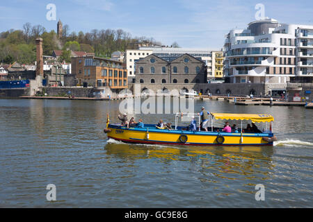 New build and conversion waterfront flat development in Bristol with harbour ferry passing in the foreground. - Stock Photo