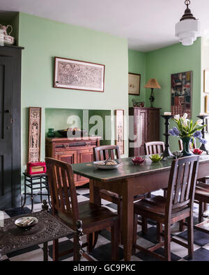William Morris style oak dining chairs at table bought in Portobello market, Nottinghill, London, UK - Stock Photo