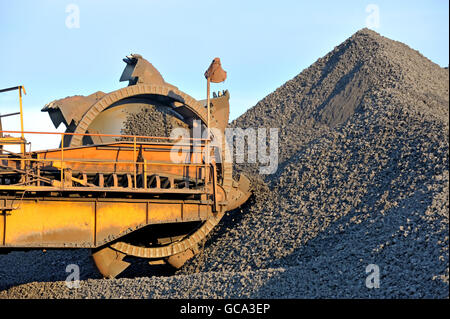 loading iron ore conveyor machine from the warehouse - Stock Photo