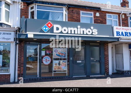 The front of a Domino's Pizza takeaway restaurant in Blackpool, Lancashire, UK - Stock Photo