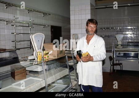 geography / travel, Germany, reunification, food shop owner is pricing the first products from West-Germany, East - Stock Photo