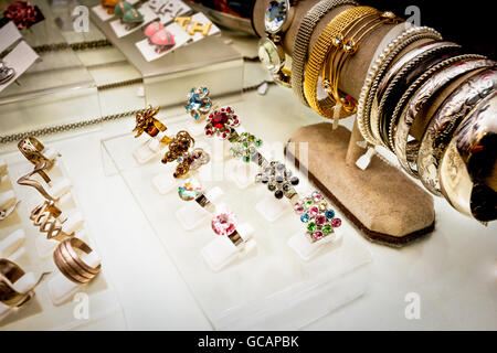 Detail of bracelets, rings and earrings that are showed to sell - Stock Photo