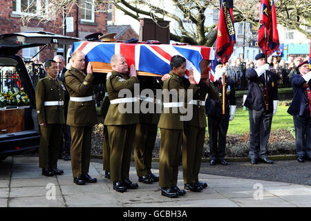 Pall bearers carry the coffin of bomb disposal expert Warrant Officer Class 2 David Markland, 36, of 36 Engineer Regiment, during his funeral at St George's Church, Chorley, Lancashire.