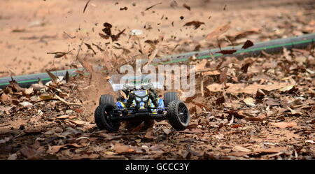 Sydney, Australia - November 30, 2014. Radio controlled buggy car model in race, internal combustion engine on a - Stock Photo