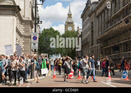 Anti- Brexit protestors wave banners against the UK Governments decision to leave European Union, crowds on street - Stock Photo