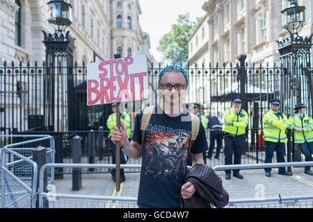 Stop Brexit Banner and Demonstrator Protest outside Downing Street London with Police corden looking on. - Stock Photo