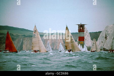 AJAXNETPHOTO. JUNE 2003. SOLENT, ENGLAND; - ROUND THE ISLAND RACE - THE FLEET PASSING THE NEEDLES LIGHTHOUSE PHOTO:JONATHAN - Stock Photo