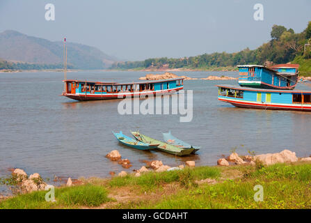 Boats on Mekong River near Luang Prabang, Laos.