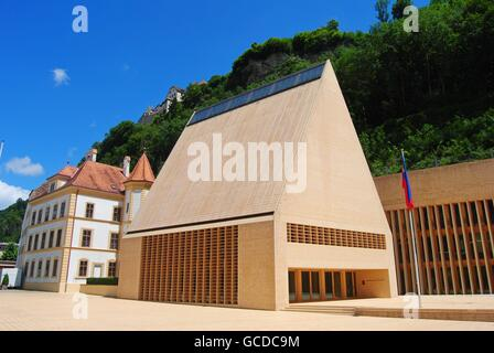 Vaduz, Liechtenstein - July 14, 2014. The Parliament building in Vaduz, with surrounding buildings, in summer. - Stock Photo