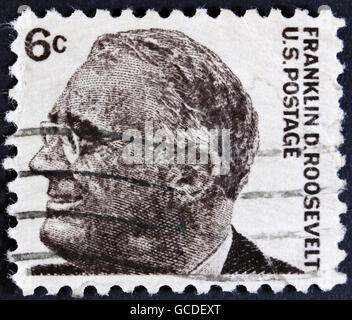UNITED STATES OF AMERICA - CIRCA 1968: A used postage stamp printed in United States shows a portrait of the President - Stock Photo
