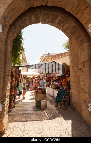 The market in Alcudia old town seen through an arch in the town walls, Alcudia old town, Mallorca ( Majorca ), Balearic - Stock Photo