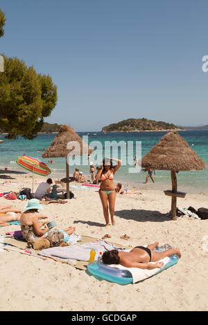 People sunbathing on Cala Formentor beach, Mallorca ( Majorca ), Balearic Islands, Spain, Europe - Stock Photo
