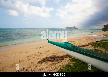 Outrigger canoe on Waimanalo Beach; Waimanalo, Oahu, Hawaii, United States of America - Stock Photo