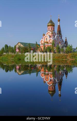 Reflection of a church in Almaty, Kazakhstan. - Stock Photo