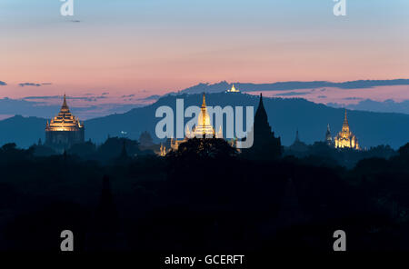 View of Thatbyinnyu temple, Ananda temple and other temples at dusk, Old Bagan, Myanmar - Stock Photo