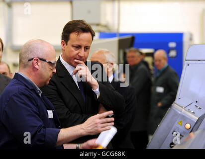 Prime Minister David Cameron visits the shop floor as work goes on at the Surgical Innovations building in Leeds, - Stock Photo