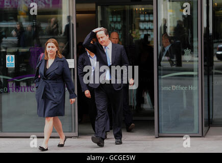 Britain's Prime Minister David Cameron leaves the Home Office in Westminster, London. Stock Photo