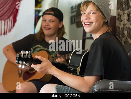 Teenage boys playing guitar. - Stock Photo