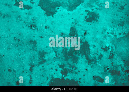Excellent turquoise grayish gray scale stone wall backgrounds: trashy with drill holes - Stock Photo
