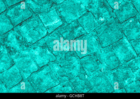 Excellent turquoise grayish gray scale stone wall backgrounds: cobblestones authentic walkway - Stock Photo