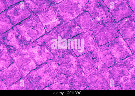 Excellent pink blue purplish turquoise bluish violet stone wall backgrounds: cobblestones authentic walkway - Stock Photo